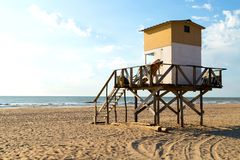 Lifeguard tower in the beach. Morning of summer. Atlantic coast. Mar de las Pampas. Argentina. Beach scene. Beautiful morning of summer. The sun bright over the stock photography