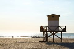 Beach in the morning. Lifeguard tower in foreground. Atlantic coast. Mar de las Pampas. Argentina. Beach scene. Beautiful morning of summer. The sun bright over royalty free stock photo