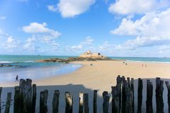 Beach scene blue sky clouds Saint-Malo france stone island ocean fortress medieval stock photos