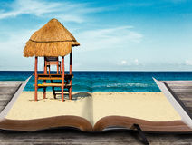 Beach scene in book. Open book with sand and ocean waves Stock Photos