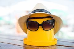 The Beach scene with bucket and sunglasses. The Beach scene with bucket, hat and sunglasses Royalty Free Stock Image