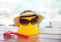 The Beach scene with bucket and sunglasses. The Beach scene with bucket, hat and sunglasses Royalty Free Stock Images