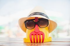 The Beach scene with bucket and sunglasses. The Beach scene with bucket, hat and sunglasses Stock Photography