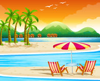 Beach scene with chairs and umbrella Royalty Free Stock Image