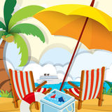 Beach scene with chairs and umbrella Royalty Free Stock Images