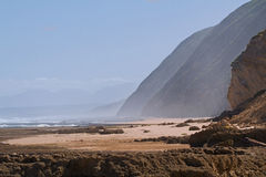 Beach scene with cliffs. Beach scene with sndstone cliffs fading into the distance Royalty Free Stock Photography