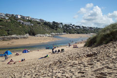 Beach scene at Cornwall, England. People on a beach at Cornwall England on a bright sunny summer day Stock Photos