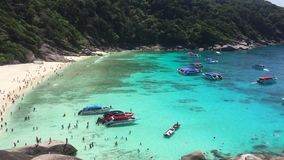 Beach Scene Filled with Speedboats Passengers Swimming, Sunbathing and Enjoying Blue Water. Similan Island, Thailand. stock video footage