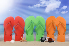 Beach scene with flip flops sandals in summer vacation stock photos