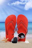 Beach scene with flip flops sandals in summer vacation Royalty Free Stock Photos