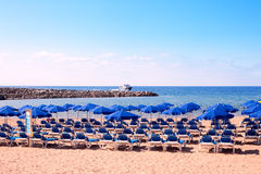 Beach scene from Gran Canaria, Canary Islands. Sunbeds and umbrellas on a beach in a morning Stock Photography