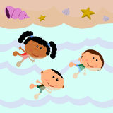 Beach scene with kids swimming Stock Photo