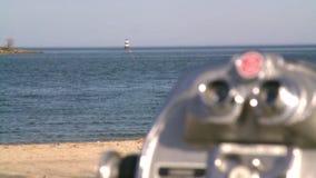 Beach scene lighthouse and pay. Racked focus of a beach scene stock footage