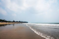 Sandy tropical beach in summer day. Beach scene with a long empty sandy beach royalty free stock photos
