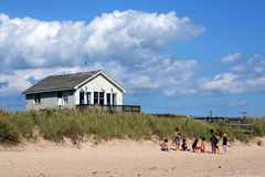 Beach Scene in Montauk. Scenic view of a kids playing on a beach in Montauk Stock Photo