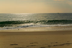 Beach scene in Nags Head NC sunrise on a clear blue day Royalty Free Stock Photo
