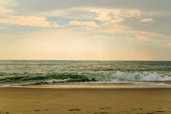 Beach scene in Nags Head NC sunrise on a clear blue day Royalty Free Stock Images