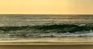 Beach scene in Nags Head NC sunrise on a clear blue day Royalty Free Stock Photography