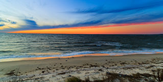 Beach scene in Nags Head NC sunset on a clear blue day Royalty Free Stock Images