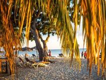 Framed beach scene at sunset. Beach scene near trinidad, cuba, framed by palm leaves at sunset Stock Image
