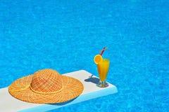 Beach scene next to swimming pool Royalty Free Stock Photos
