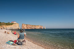 Beach scene at Perce Rock Stock Photos