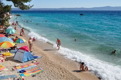 Beach scene with people in Podgora, Croatia Royalty Free Stock Photo