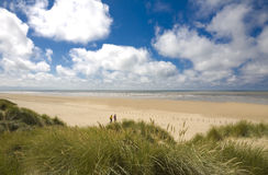 Beach scene with sand dunes. Sunny summer day beach scene with dunes and sandy path to beach - Ainsdale on Sea, Sefton Coast, UK Stock Photos