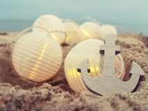 Fairylights and anchor at the beach stock images