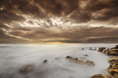 Beach scene with stunning cloud formation Stock Photography
