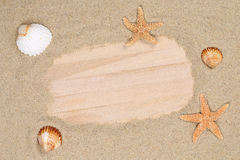 Beach scene in summer holiday with sand, sea shells, stars and c Royalty Free Stock Photography