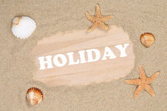 Beach scene in summer holiday with sand, sea shells and stars Royalty Free Stock Photo
