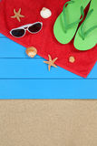 Beach scene in summer on vacation with sand, sunglasses and towe Royalty Free Stock Photography