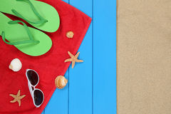 Beach scene in summer on vacation with sunglasses and towel Stock Photos