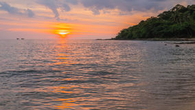 A beach scene with sunset in the background at Kood island, Thai Stock Photography