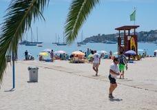 Beach scene with tourists Stock Photos