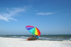 Beach Scene with Umbrella Royalty Free Stock Photography