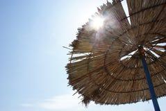 Beach scene. A beach umbrella under the sun Royalty Free Stock Photography