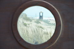 Beach scene. Viewed through a round window Stock Photo