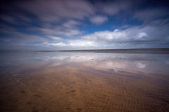 Beach scene Westward Ho!. The very beautiful and reflective Westward Ho! beach in North Devon , England Stock Photography