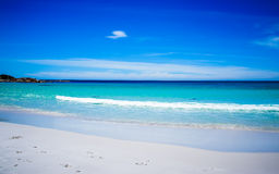 Beach scene with white sand and turquoise water Royalty Free Stock Image