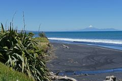 Beach scenery with volcano and black sand royalty free stock photo