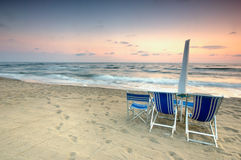 Beach scenic at sunset stock images
