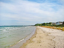 Beach in Scharbeutz, baltic sea, germany. Ocean and beach, view towards Timmendorfer Strand Stock Images