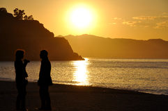 The beach in Scilla. A sunset on the beach in Scilla (Reggio Calabria), as people relax Royalty Free Stock Photos