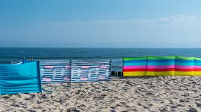 Beach screen on the Polish beach on a sunny summer day in the background beautiful sea. Beach screen on the Polish beach on a sunny summer day in the background Royalty Free Stock Photography