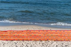 Beach screen on the Polish beach on a sunny summer day in the background beautiful sea. Beach screen on the Polish beach on a sunny summer day in the background Stock Photo