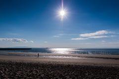 Beach with sea against blue sky. Stock Photography