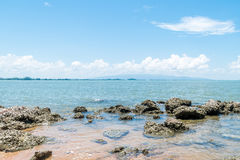 Beach and sea with blue sky and reef rock beach Royalty Free Stock Photos