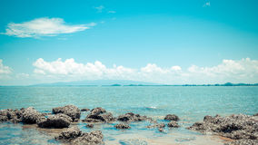 Beach and sea with blue sky and reef rock beach Royalty Free Stock Photography